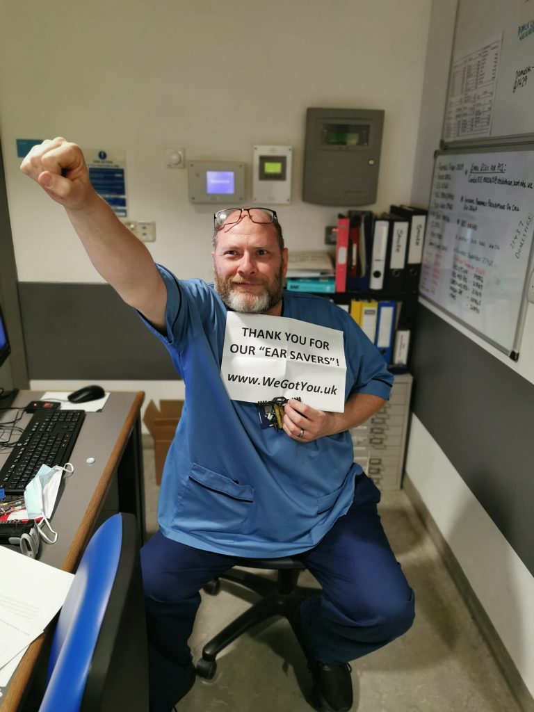 nhs fife employee with 3d printed ear saver donated by we got you